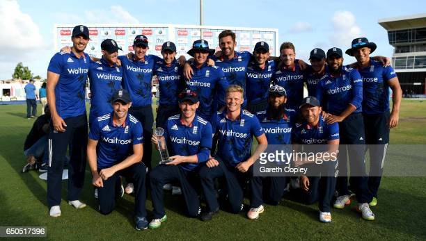 England celebrate with the series trophy after winning the 3rd One Day International between the West Indies and England at Kensington Oval on March...