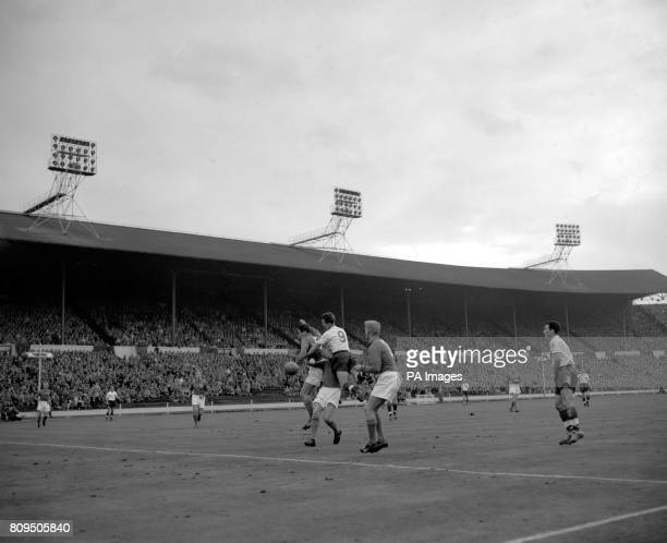 England centre forward Brian Clough is sandwiched between three Swedish players as he attempts to head a goal for England but fails The Swedish...