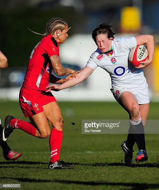 England centre Megan Goddard is tackled by Adi Taviner during the Six Nations championship match between Wales and England at St Helens RFC on...