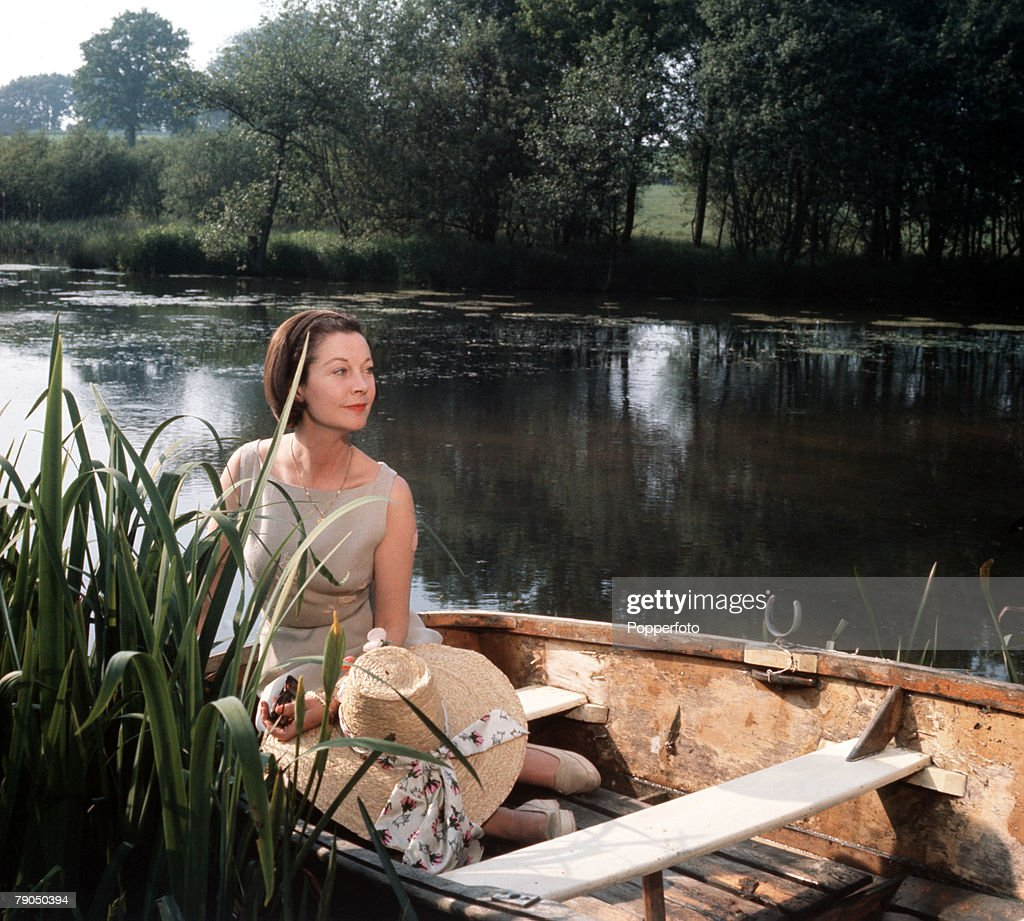 England, Circa 1960's, British actress Vivien Leigh is pictured on the lake at Tickerage Mill