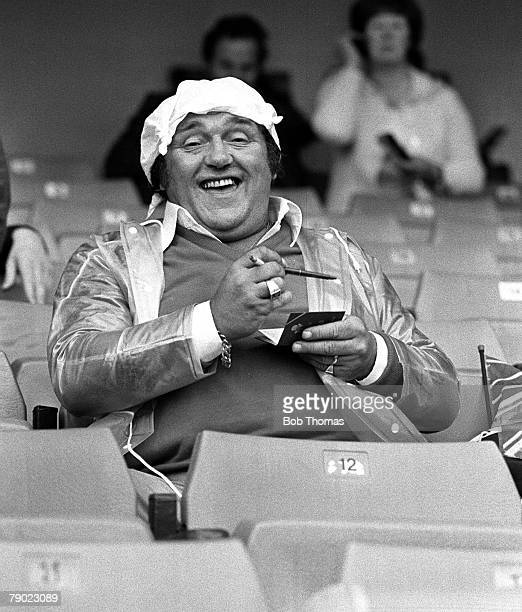 England Circa 1985 British comedian and entertainer Les Dawson signs autographs at a football match