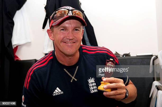 England coach Andy Flower celebrates with the Ashes Urn in the changing room following the fifth npower Test Match at the Oval on august 23 2009 in...