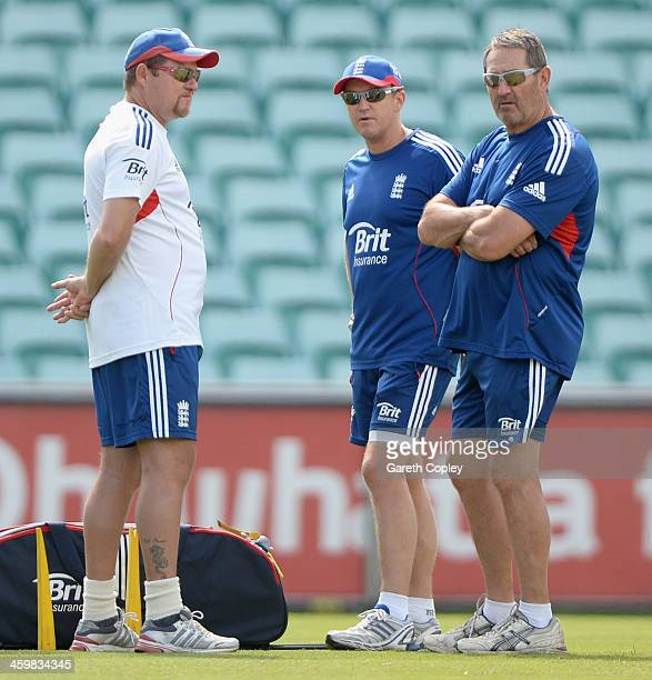 England coach Andy Flower speaks with bowling coach David Saker and batting coach Graham Gooch during a nets session at Sydney Cricket Ground on...