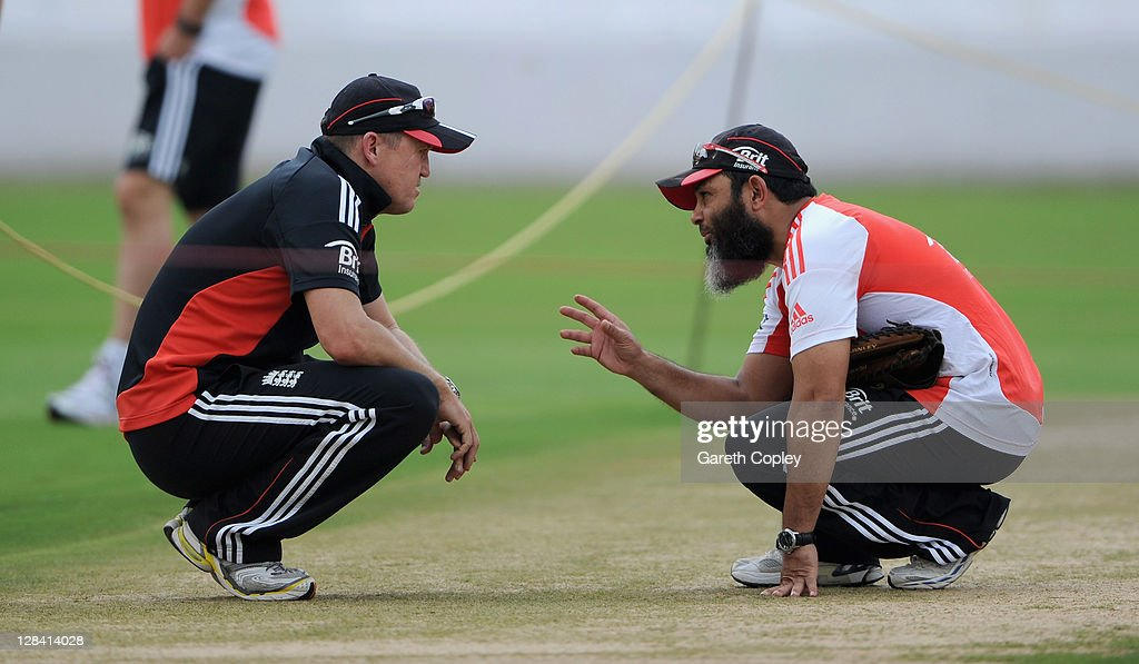 England coach Andy Flower speaks with spin bowling coach Mushtaq Ahmed during a nets session at The Rajiv Gandhi International Cricket Stadium on...