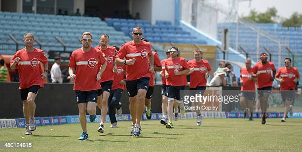 England coach Ashley Giles leads his team as he takes part in the Sport Relief mile at Zahur Ahmed Chowdhury Stadium on March 23 2014 in Chittagong...