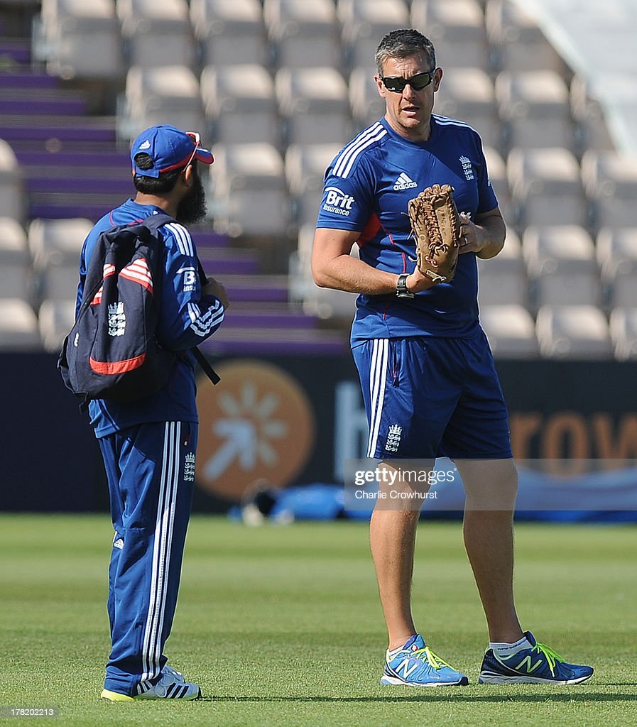 England coach Ashley Giles talks to Mushtaq Ahmed during the England Nets Session at The Ageas Bowl on August 27 2013 in Southampton England