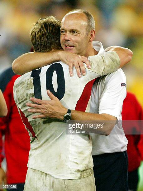 England coach Clive Woodward celebrates with Jonny Wilkinson during the Rugby World Cup Final match between Australia and England at Telstra Stadium...