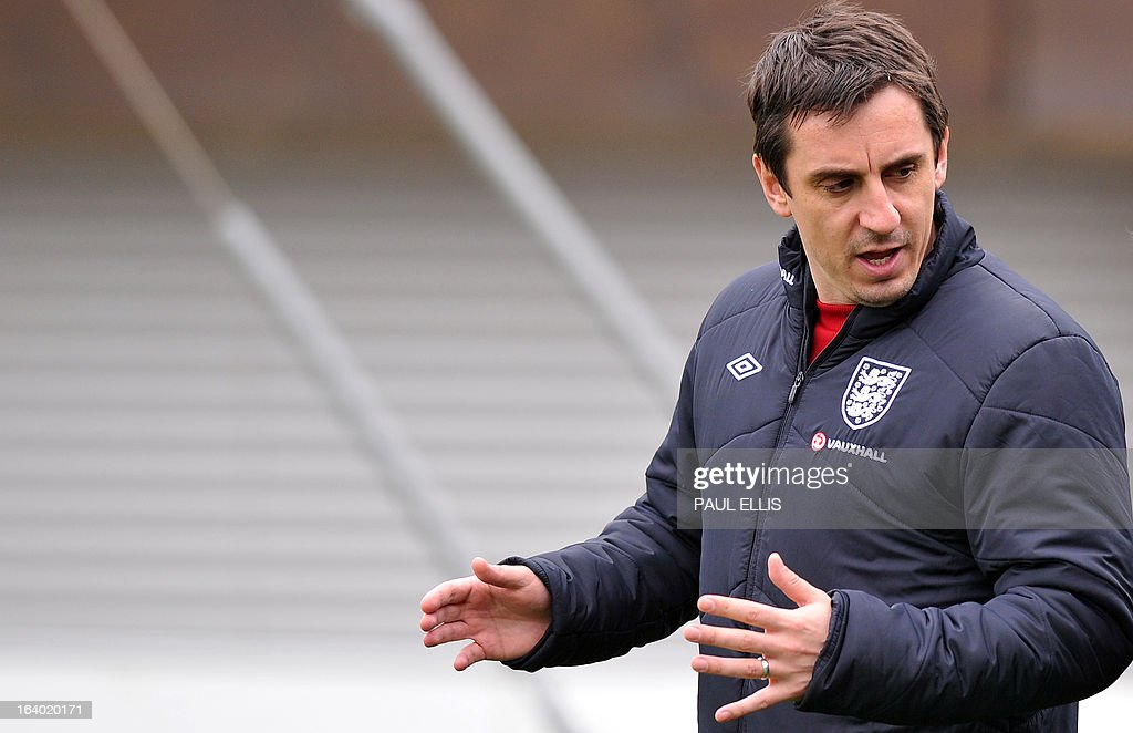 England coach Gary Neville arrives for a training session at the St George's Park training complex, near Burton-upon-Trent, central England on March 19, 2013 ahead of their 2014 World Cup qualifier football match against San Marino on March 22.