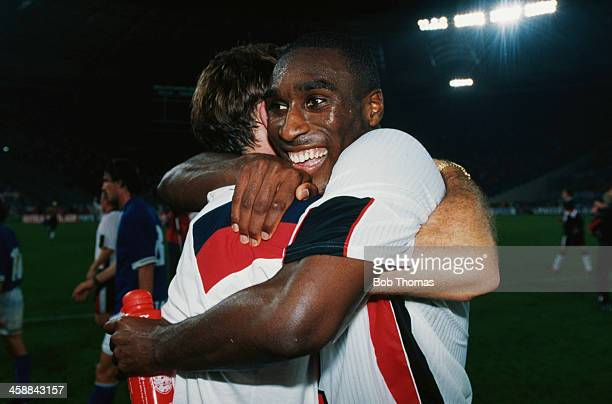 England Coach Glenn Hoddle embraces Sol Campbell after a 0 0 draw against Italy ensures England will qualify for the 1998 FIFA World Cup Rome Italy...