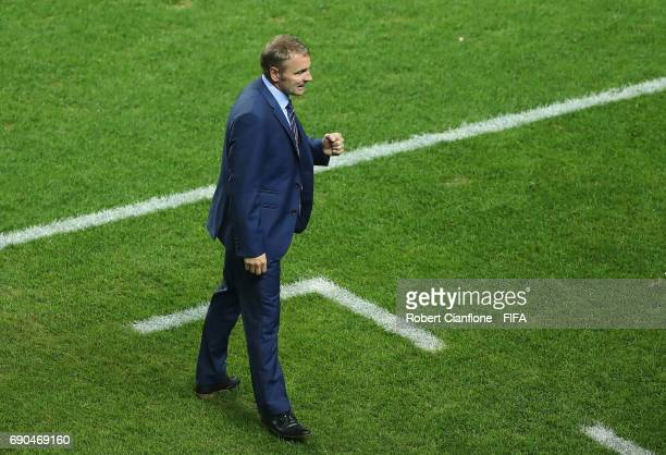 England coach Paul Simpson celebrates after England defeated Costa Rica during the FIFA U20 World Cup Korea Republic 2017 Round of 16 match between...
