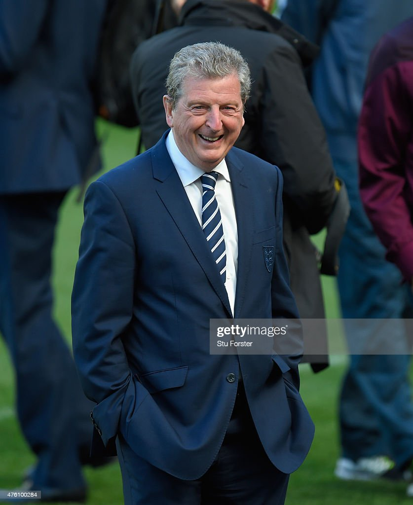 England coach <a gi-track='captionPersonalityLinkClicked' href=/galleries/search?phrase=Roy+Hodgson&family=editorial&specificpeople=881703 ng-click='$event.stopPropagation()'>Roy Hodgson</a> raises a smile as his team go for a stroll on the pitch ahead of Sunday's friendly internmational against the Republic of Ireland at Aviva Stadium on June 6, 2015 in Dublin, Ireland.