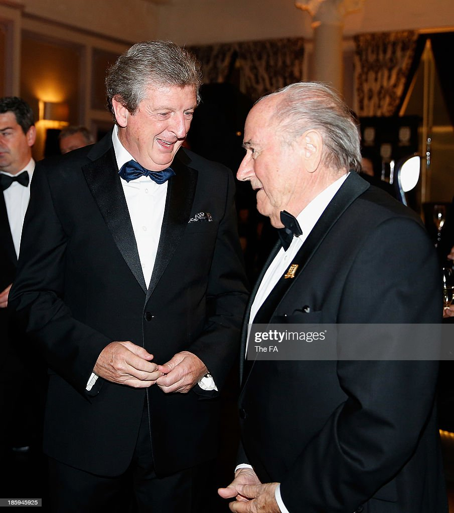 England Coach <a gi-track='captionPersonalityLinkClicked' href=/galleries/search?phrase=Roy+Hodgson&family=editorial&specificpeople=881703 ng-click='$event.stopPropagation()'>Roy Hodgson</a> talks to Joseph Blatter, FIFA President during the FA150 Gala Dinner commemorating the Football Association's 150th year at the Grand Connaught Rooms on October 26, 2013 in London, England.