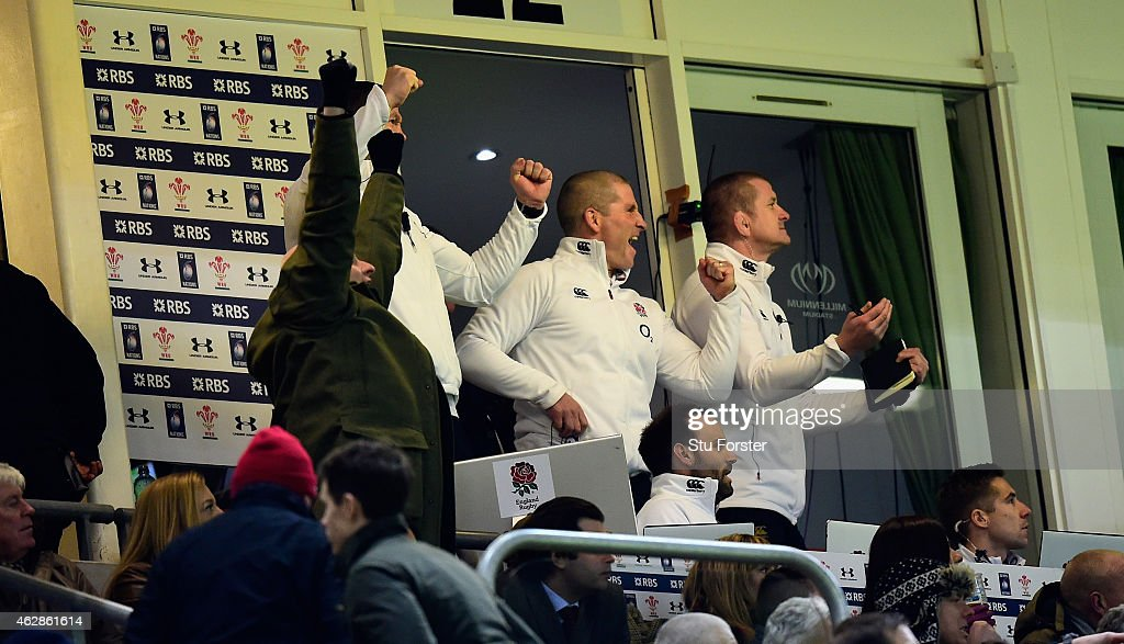 England coach Stuart Lancaster and his staff celebrate victory from their box during the RBS Six Nations match between Wales and England at Millenium...