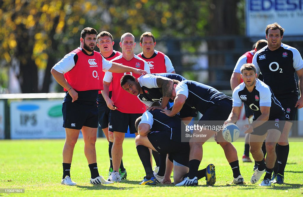 England coach Stuart Lancaster looks on as scrum half Richard Wigglesworth releases the ball during England training at the Jockey Club on June 6...