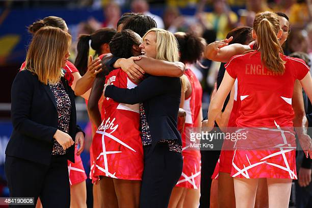 England coach Tracey Neville celebrates with players after victory in the 2015 Netball World Cup Bronze Medal match between England and Jamaica at...