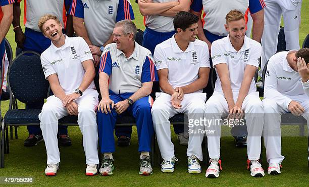 England coach Trevor Bayliss shares a joke with Joe Root as captain Alastair Cook and Stuart Broad chat whilst waiting for the team picture to be...