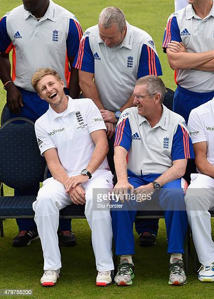 England coach Trevor Bayliss shares a joke with Joe Root whilst waiting for the team picture to be taken before a nets session ahead of the 1st...
