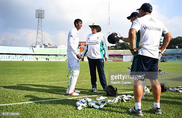 England coach Trevor Bayliss speaks with Haseeb Hameed as he leaves the field for tea during day two of the tour match between a Bangladesh Cricket...