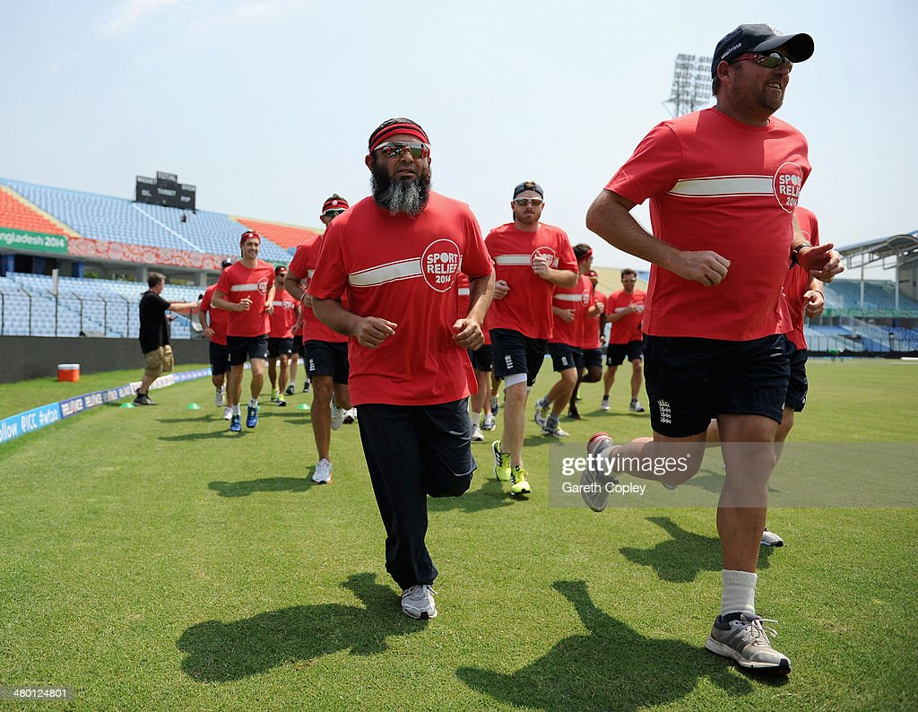 England coaches Mushtaq Ahmed and David Saker takes part in the Sport Relief mile at Zahur Ahmed Chowdhury Stadium on March 23 2014 in Chittagong...