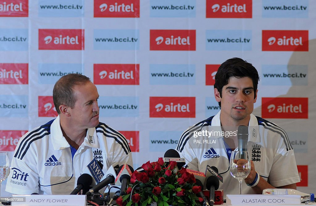 England cricket captain Alastair Cook (R) speaks as team director Andy flower looks on during a press conference in Mumbai on October 29, 2012. The England cricket team is in India to play a four Test match series which starts on November 15.