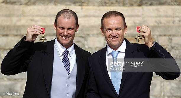 England cricket captain Andrew Strauss and England cricket coach Andy Flower pose with their OBE's received from the Princess Royal during an...