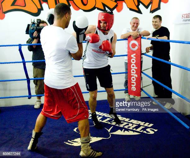 England cricket captain Andrew Strauss boxing training with Olympic gold medal winner James DeGale during an open training session at the LA Academy...