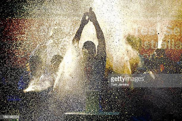 England cricket captain Andrew Strauss is sprayed with champagne as he lifts the the Ashes urn following victory in the 5th and final test match...