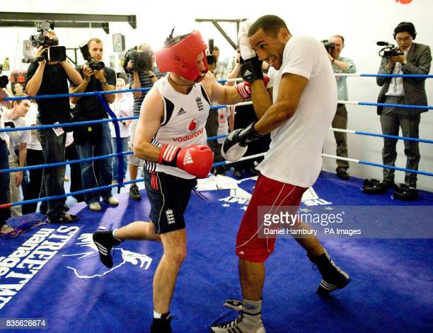 England cricket captain Andrew Strauss spars with Olmpic gold medal winner James De Gale during an open training session at the LA Academy in...