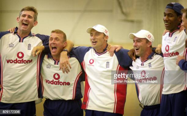 England cricket captain Nasser Hussain and team mates cheering their team in a penalty shoot out during a football game before a training session at...