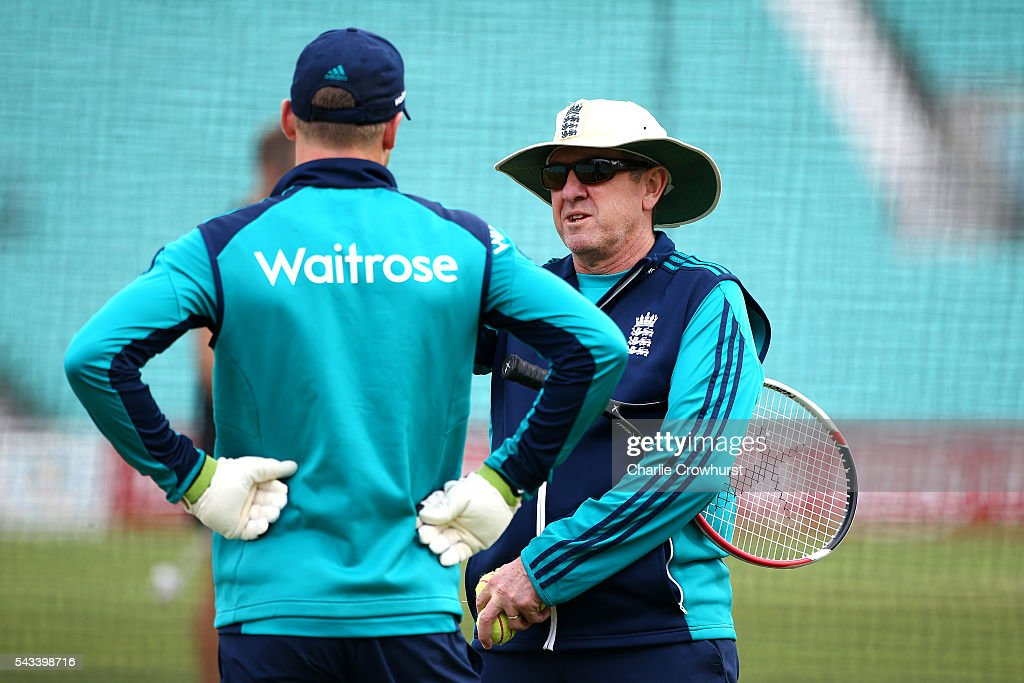 England cricket head coach Trevor Bayliss chats with wicket keeper Jos Buttler during an England & Sri Lanka Nets Session at The Kia Oval on June 28, 2016 in London, England.