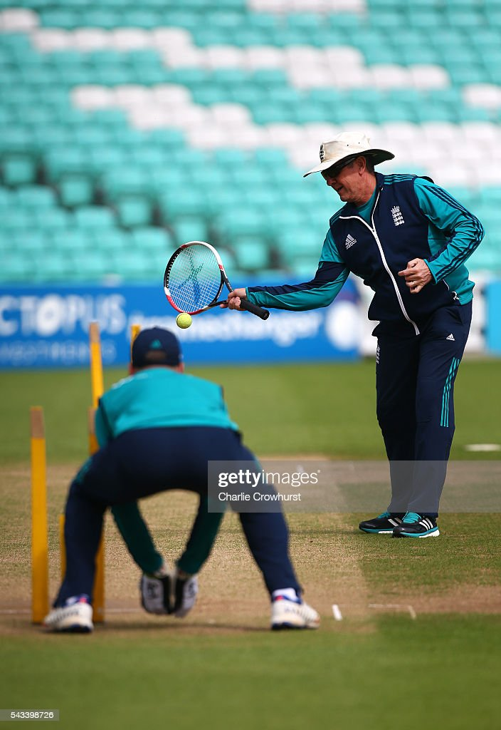 England cricket head coach Trevor Bayliss trains with wicket keeper Jos Buttler during an England & Sri Lanka Nets Session at The Kia Oval on June 28, 2016 in London, England.