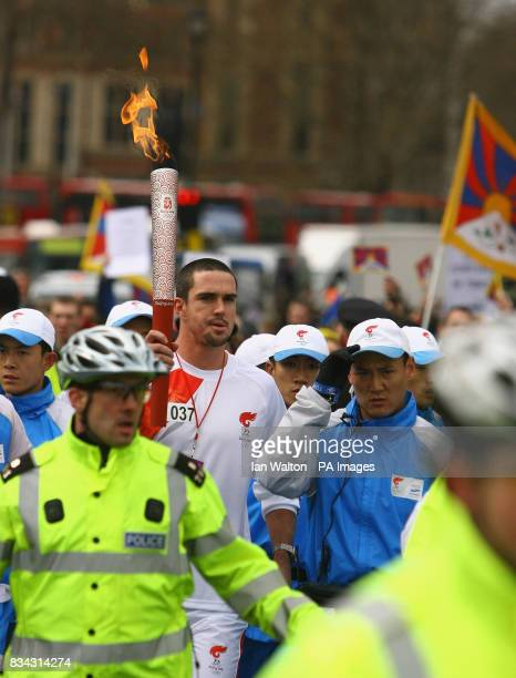 England cricket player Kevin Pietersen carries the Olympic torch during its relay journey across London on its way to the lighting of the Olympic...