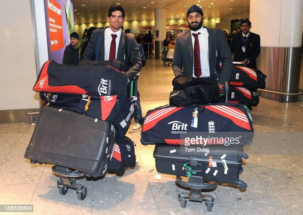 England Cricket Team Captain Alastair Cook and Monty Panesar arrive at Heathrow Airport on December 18 2012 in London England