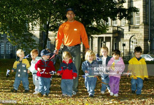 England cricketer Adam Hollioake poses with nursery children in Edinburgh ahead of his charity journey from Edinburgh to Tangiers to raise money in...