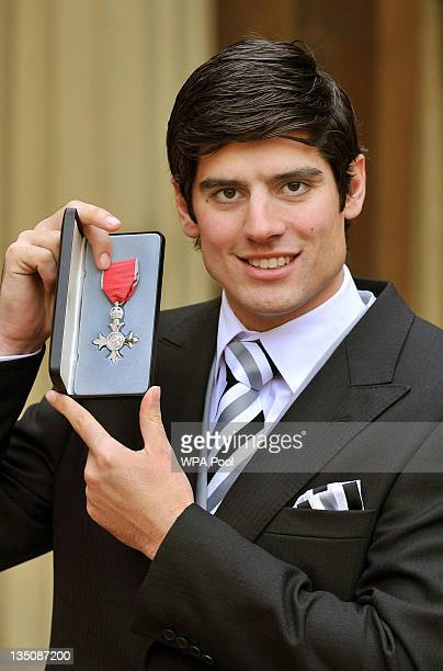 England cricketer Alastair Cook poses after being made an MBE by Queen Elizabeth II during an Investiture ceremony at Buckingham Palace on December 6...
