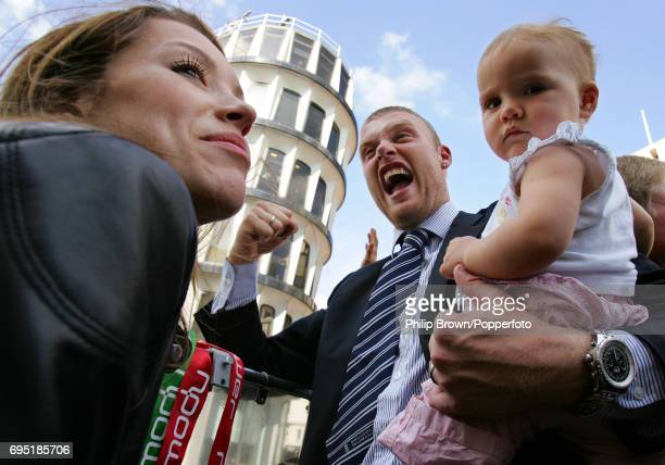 England cricketer Andrew Flintoff with daughter Holly and wife Rachel on the Victory Bus on route to Trafalgar Square in London after England had won...