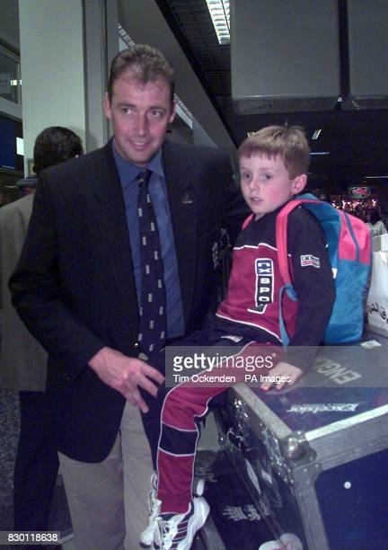 England cricketer Angus Fraser with his son Alexander at Heathrow Airport today Friday January 8 after returning home from Australia Photo by Tim...