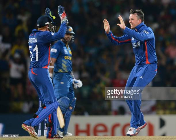 England cricketer Graeme Swann celebrates the wicket of Sri Lanka cricketer Kumar Sangakkara during the ICC Twenty20 Cricket World Cup's Super Eight...