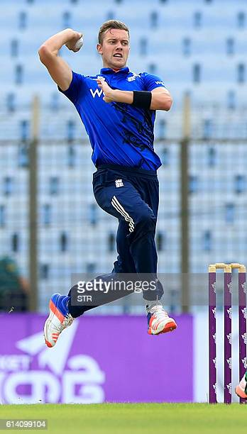 England cricketer Jake Ball delivers a ball during the third and final one day international cricket match between Bangladesh and England at the...