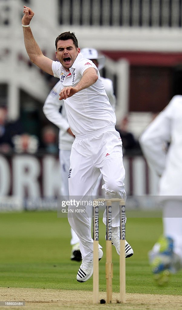 England cricketer James Anderson (L) celebrates the dismissal of New Zealand's Hamish Rutherford for four runs during the second day of the first International Test cricket match between England and New Zealand at Lord's cricket ground in London on May 17, 2013. New Zealand's Tim Southee took two wickets in two balls as England collapsed on the second day of the first Test at Lord's. At lunch, England, who had won the toss, were 209 for eight, having lost four wickets for nine runs in 17 balls against accurate New Zealand seam bowling in overcast conditions. AFP PHOTO / GLYN KIRK