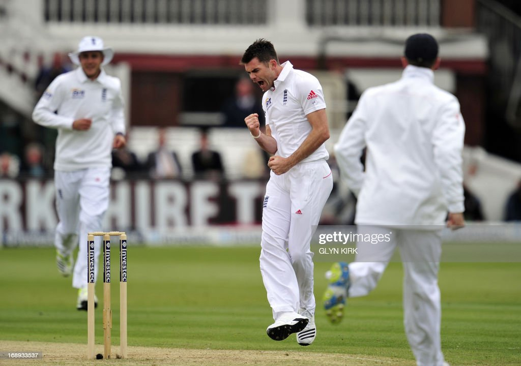 England cricketer James Anderson (C) celebrates the dismissal of New Zealand's Hamish Rutherford for four runs during the second day of the first International Test cricket match between England and New Zealand at Lord's cricket ground in London on May 17, 2013. New Zealand's Tim Southee took two wickets in two balls as England collapsed on the second day of the first Test at Lord's. At lunch, England, who had won the toss, were 209 for eight, having lost four wickets for nine runs in 17 balls against accurate New Zealand seam bowling in overcast conditions. AFP PHOTO / GLYN KIRK
