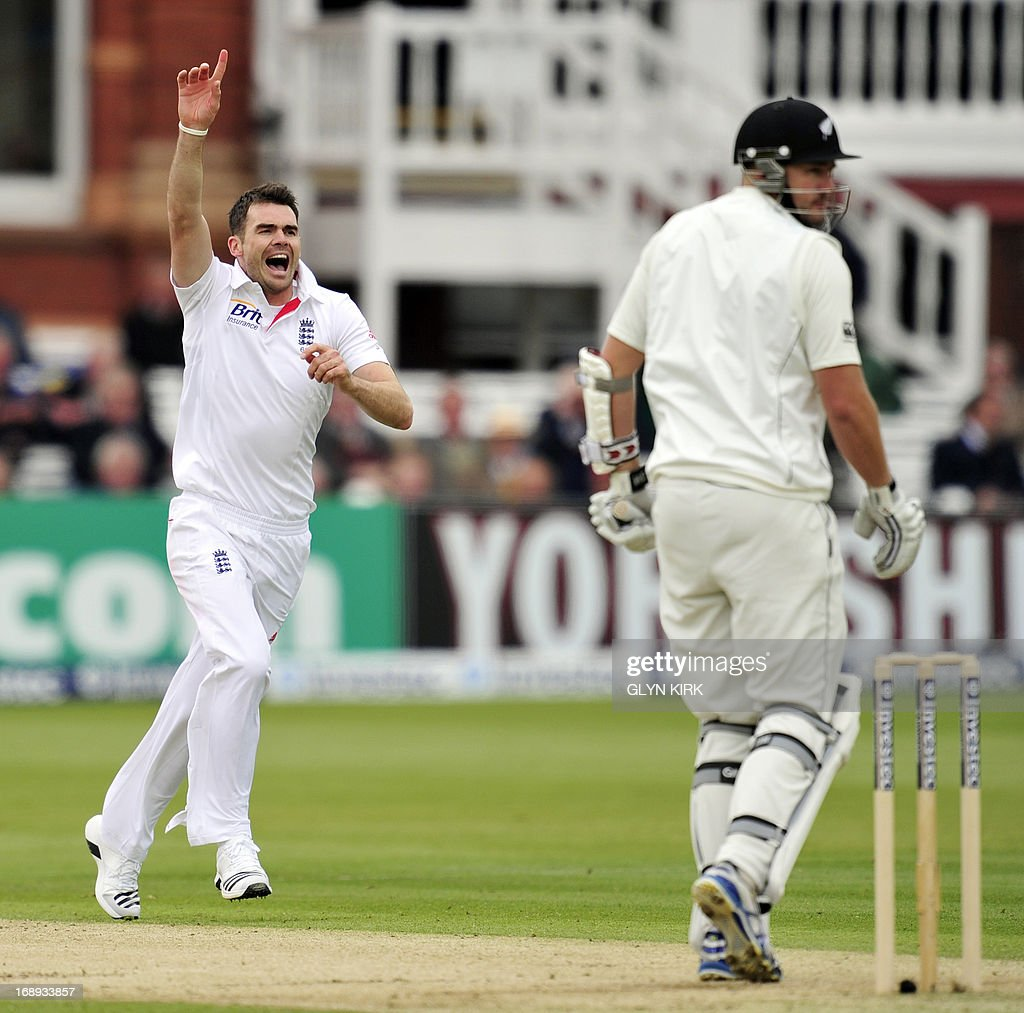 England cricketer James Anderson (L) celebrates the dismissal of New Zealand's Peter Fulton for two runs during the second day of the first International Test cricket match between England and New Zealand at Lord's cricket ground in London on May 17, 2013. New Zealand's Tim Southee took two wickets in two balls as England collapsed on the second day of the first Test at Lord's. At lunch, England, who had won the toss, were 209 for eight, having lost four wickets for nine runs in 17 balls against accurate New Zealand seam bowling in overcast conditions. AFP PHOTO / GLYN KIRK