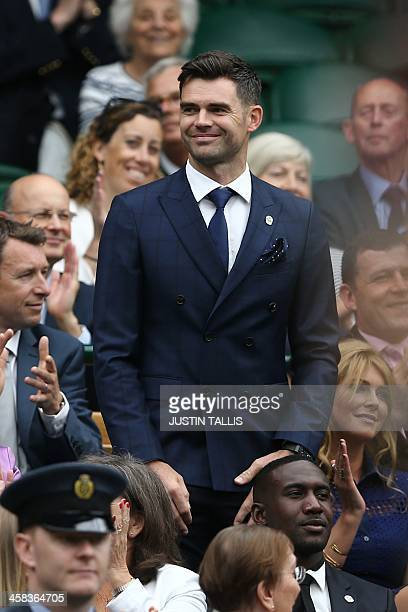 England cricketer James Anderson stands in the royal box on centre court as he is introduced on the sixth day of the 2016 Wimbledon Championships at...
