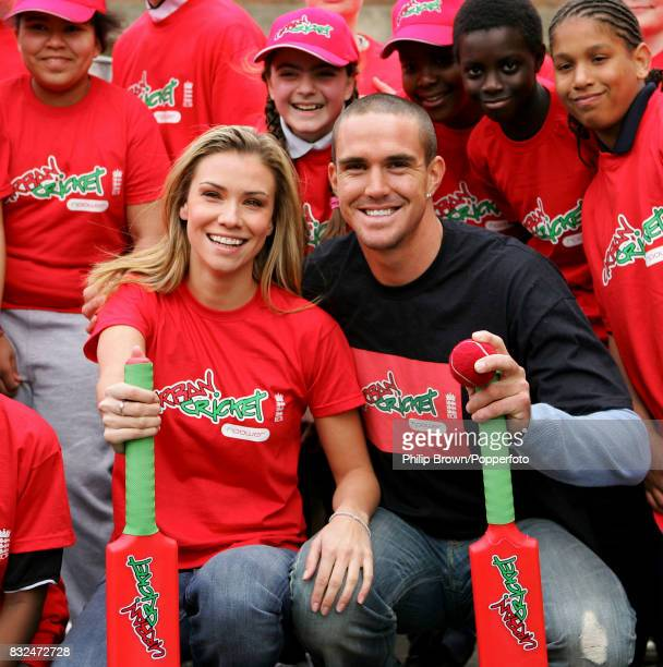 England cricketer Kevin Pietersen with his girlfriend Jessica Taylor of the pop group Liberty X and local children at the launch of Urban Cricket a...