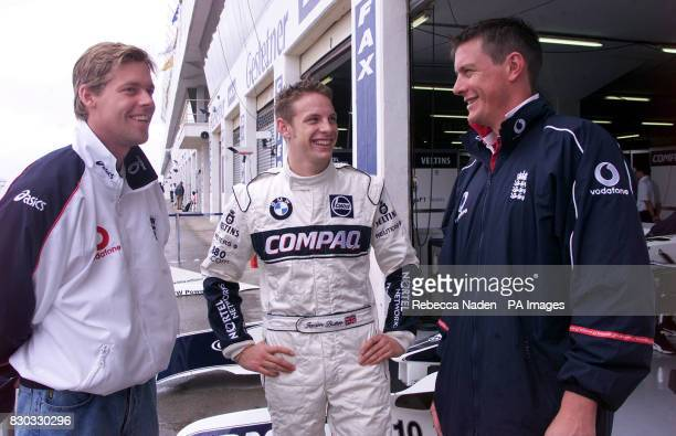 England cricketer Nick Knight with British Formula One Williams driver Jenson Button and cricketer Ashley Giles in the pits at Kyalami race track...