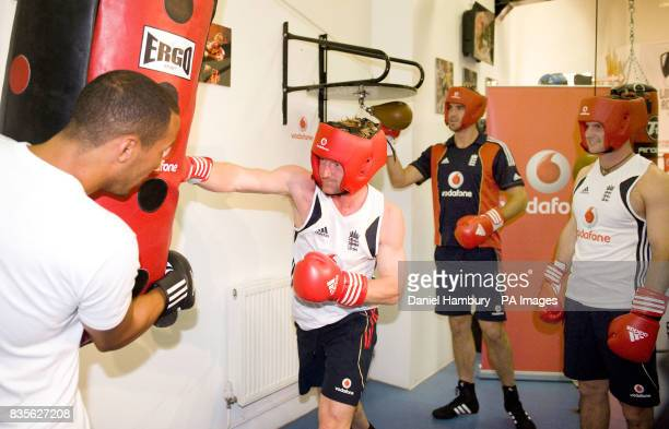 England cricketer Paul Collingwood boxing training with Olympic gold medal winner James DeGale as team mates Kevin Pietersen and Andrew Strauss look...