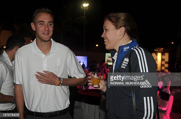 England cricketer Stuart Broad talks with his sister Gemma Broad at a reception in Mumbai on November 28 2012 The British High Commissioner hosted a...