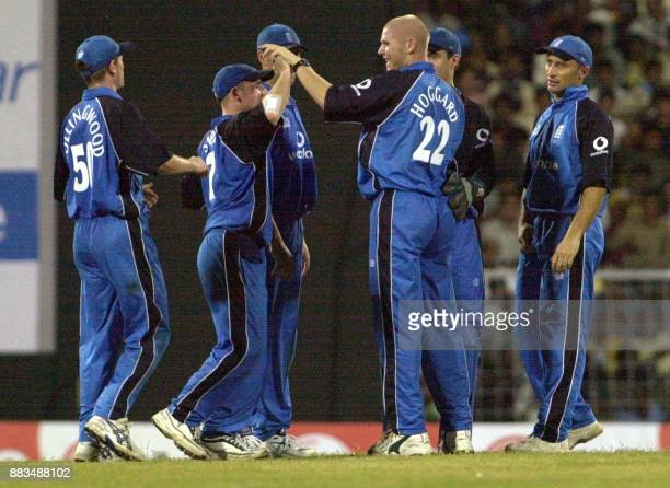 England cricketers congratulate compatriot Mathew Hoggard after claiming the wicket of an Indian batsman during the third oneday match at the MA...