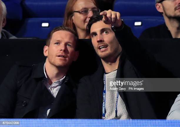 England Cricketers Eoin Morgan and Steven Finn in the crowd during day six of the NITTO ATP World Tour Finals at the O2 Arena London