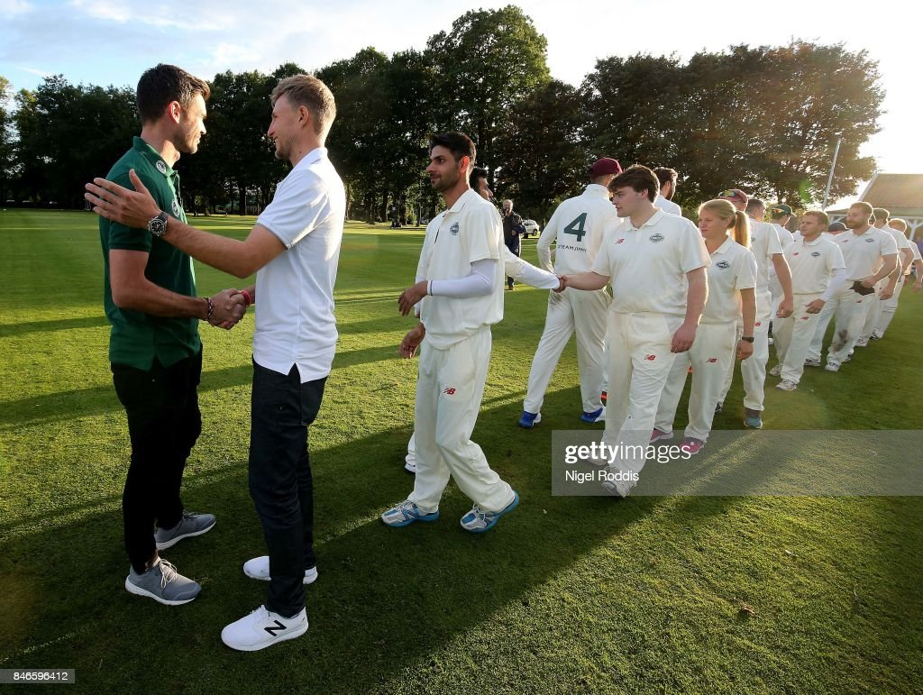 England cricketers Joe Root (2ndL) and James Anderson (L) react with players after the Brut T20 Cricket match betweenTeam Jimmy and Team Joe at Worksop College on September 13, 2017 in Worksop, England.
